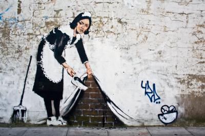 Fototapeta Graffiti in an alley Maid Sweeping by Banksy