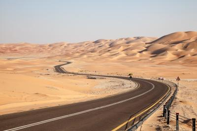 Road through the desert to the moreeb dune in liwa oasis