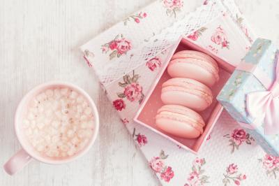 Fototapeta Pink macaroons in gift box with cup of coffee