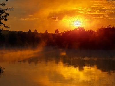 Fototapeta Symbol Kwiatu Życia na tle krajobrazu nad jeziorem