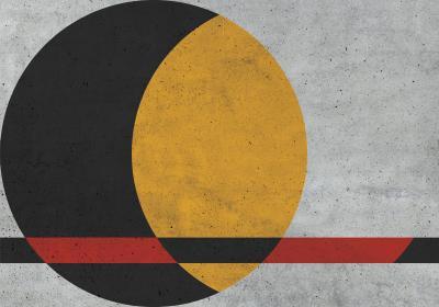 Fototapeta Czarno-żółte koło z elementem czerwieni na betonowej fakturze