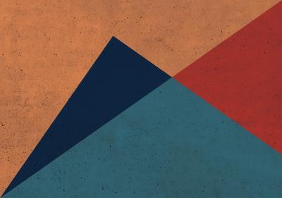 Fototapeta Trójkąty różnoboczne z dominującym pomarańczem na betonowym tle