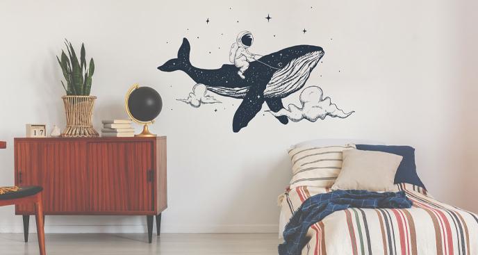 Naklejka astronauta i wieloryb