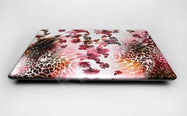 Naklejka na laptopa kwiaty i cętki