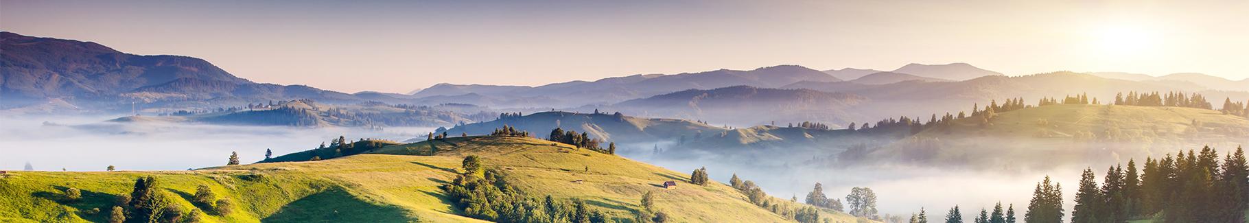 Obraz krajobraz górski o zachodzie słońca