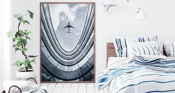 Plakat samolot nad wieżowcem